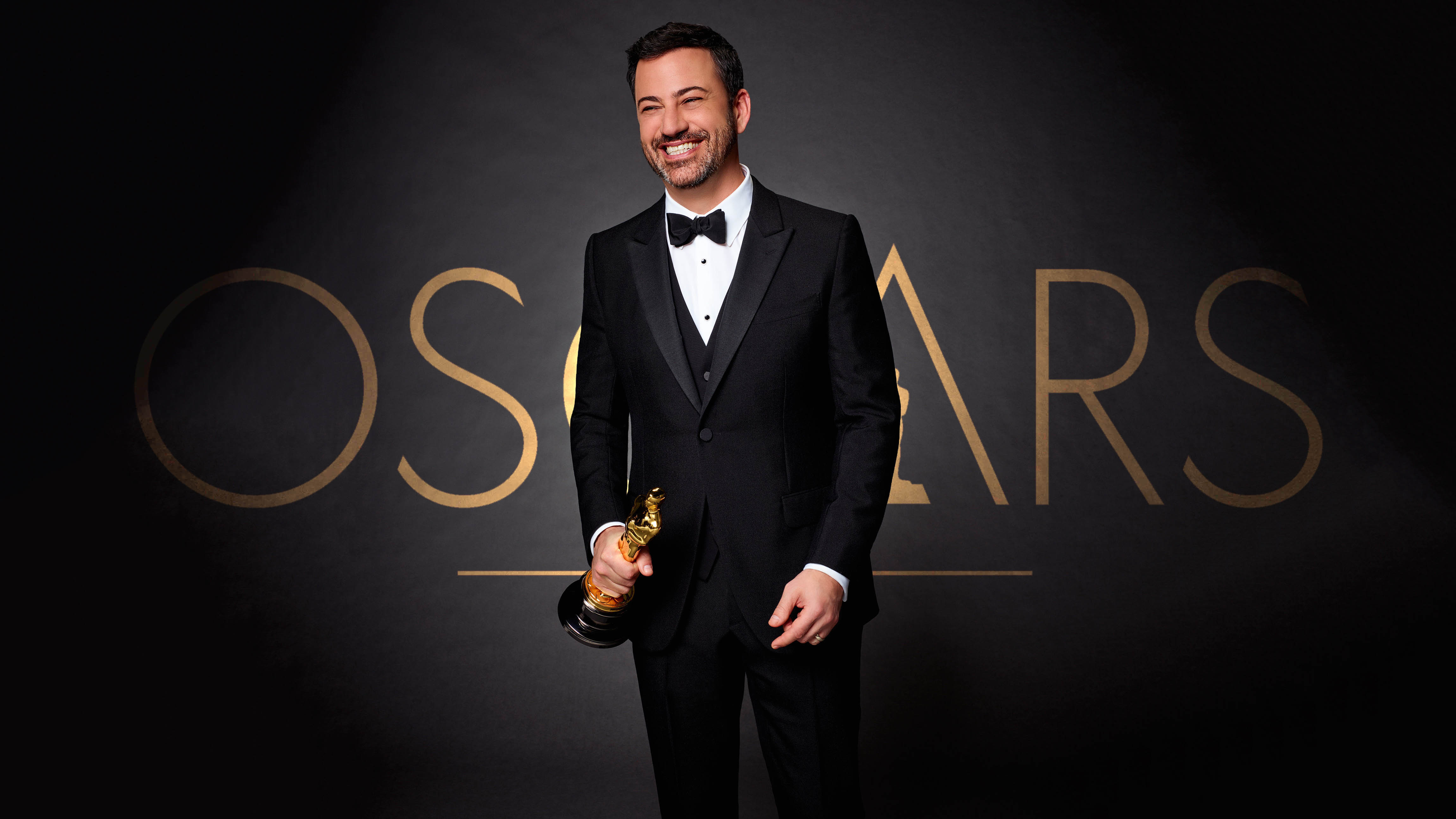 Jimmy Kimmel holding an Oscar statue