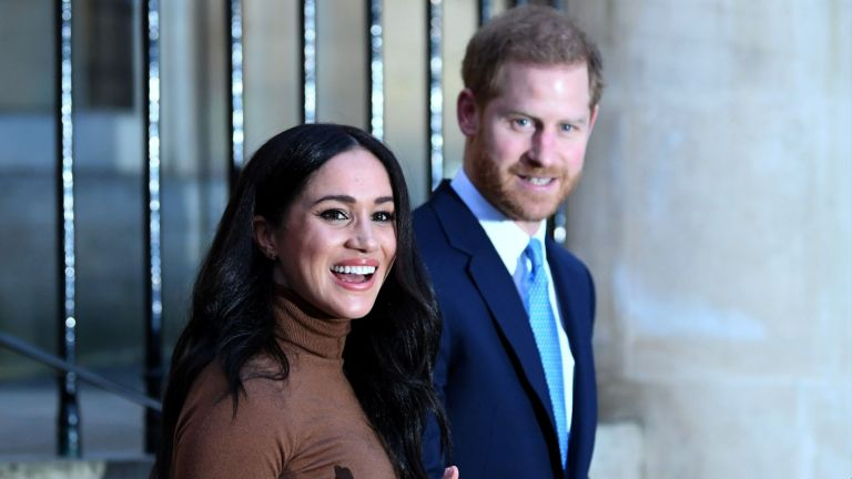 Prince Harry, Duke of Sussex wears suit and Meghan, Duchess of Sussex wears brown turtle neck jumper after their visit to Canada House
