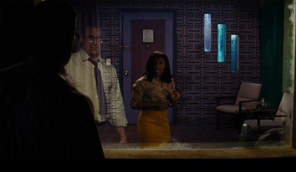 Jon Hamm watching Cynthia Erivo sing through a two way mirror in Bad Times At The El Royale