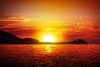 A sunrise on a hot summer day.