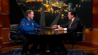 TV comedian Stephen Colbert discusses NASA's Mars rover Curiosity landing with astronaut John Grunsfeld, NASA's associate administrator for science missions, on Aug. 1, 2012.