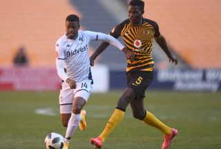 Phathutshedzo Nange of Bidvest Wits challenged by Anthony Agay of Kaizer Chiefs