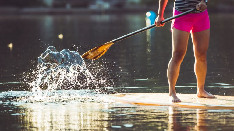 person stand-up paddle boarding
