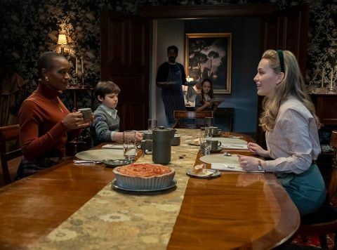Dani, Hannah, Miles, Flora and Owen all sit down for a meal in 'The Haunting of Bly Manor.'