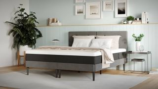 Best Mattress UK 2021: Image shows the Emma Original Mattress on a grey bed frame in a white bedroom