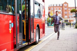 Man running to catch a bus.