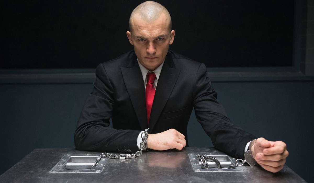 Hitman Agent 47 the Hitman handcuffed to a table