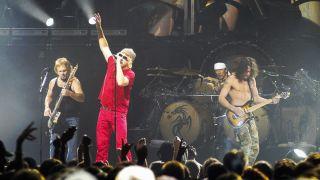 Van Halen performs on stage at Oakland Arena, Oakland, California, United States on 1st August, 2004. L-R Michael Anthony, Sammy Hagar, Eddie Van Halen.