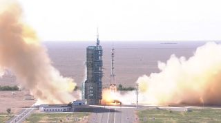 A Chinese Long March 2F rocket launches three astronauts on the Shenzhou 12 mission to the country's new Tiangong space station core module Tianhe from the Jiuquan Satellite Launch Center in northwest China at 9:22 a.m. Beijing Time on June 17, 2021.