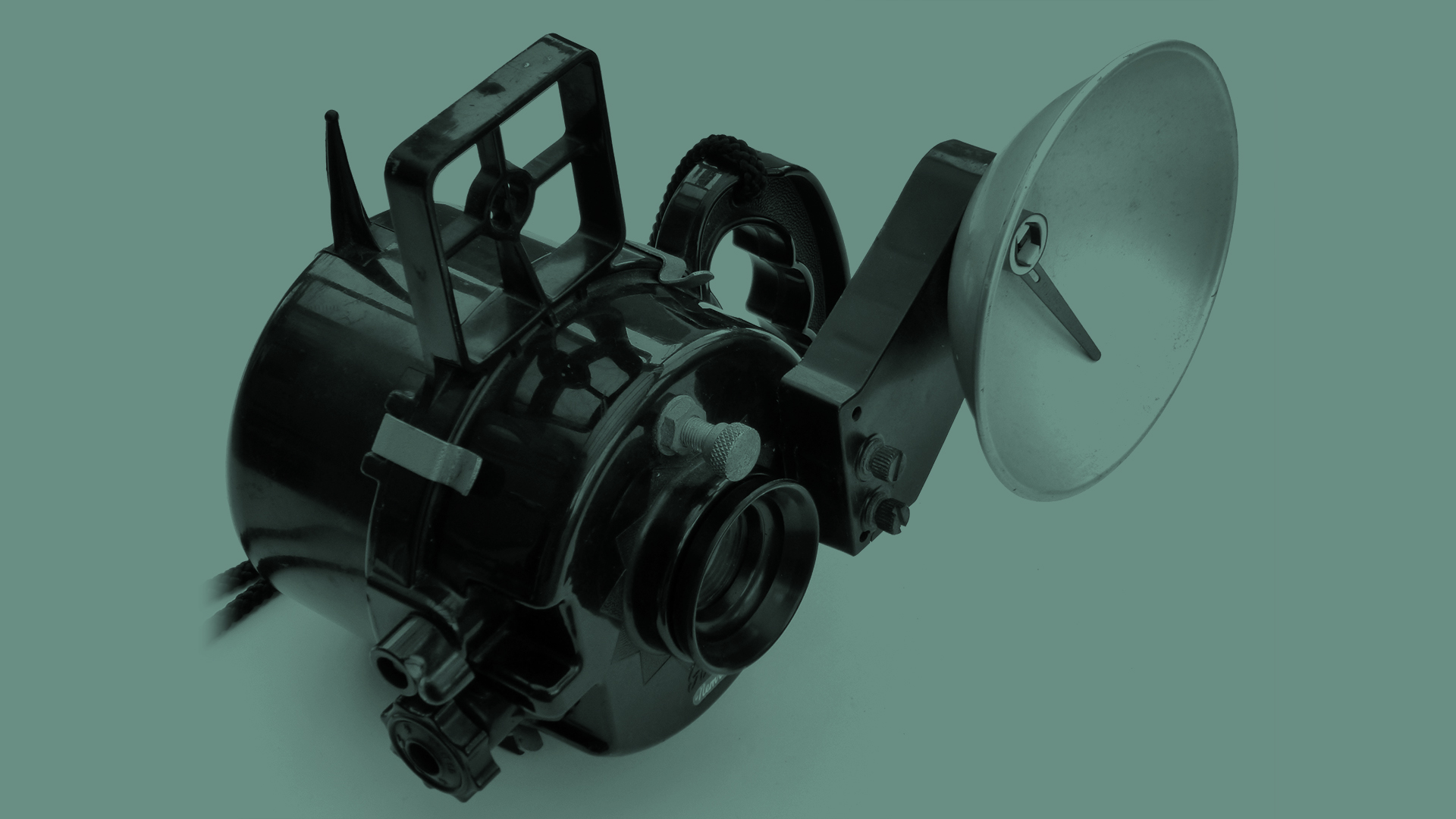 The front of the Nemrod Siluro underwater camera on a green background