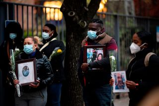 Nurses and healthcare workers mourn and remember their colleagues who died of COVID-19 during a demonstration outside Mount Sinai Hospital in Manhattan on April 10, 2020.
