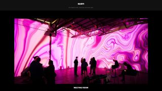 A screen capture of interactive artist Marpi's website, featuring his installation melting room in which pink colours swirl across the walls of a gallery space.