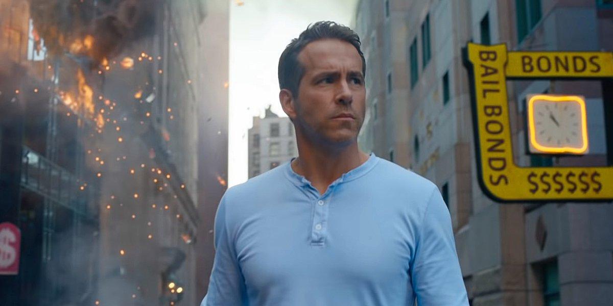 Ryan Reynolds walks around the city looking upset in Free Guy