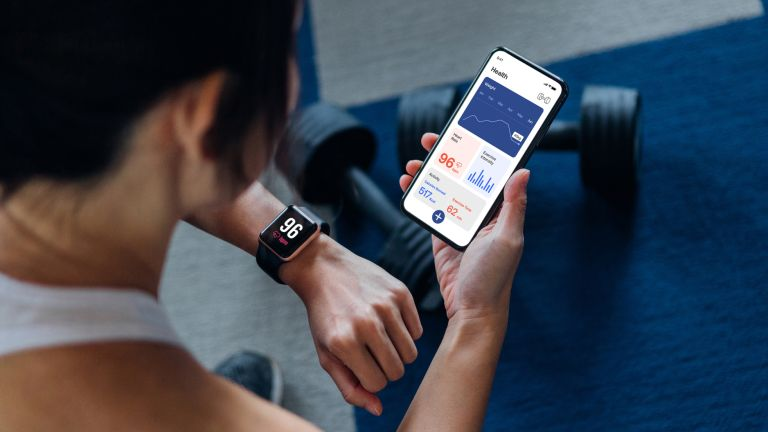 woman using a fitness watch