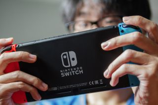 A man playing Nintendo Switch