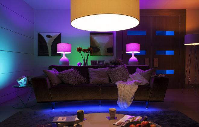 A lounge lit with Philips Hue smart light bulbs