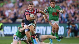 James Tedesco of the Roosters runs the ball during the 2019 NRL Grand Final match between the Canberra Raiders and the Sydney Roosters.