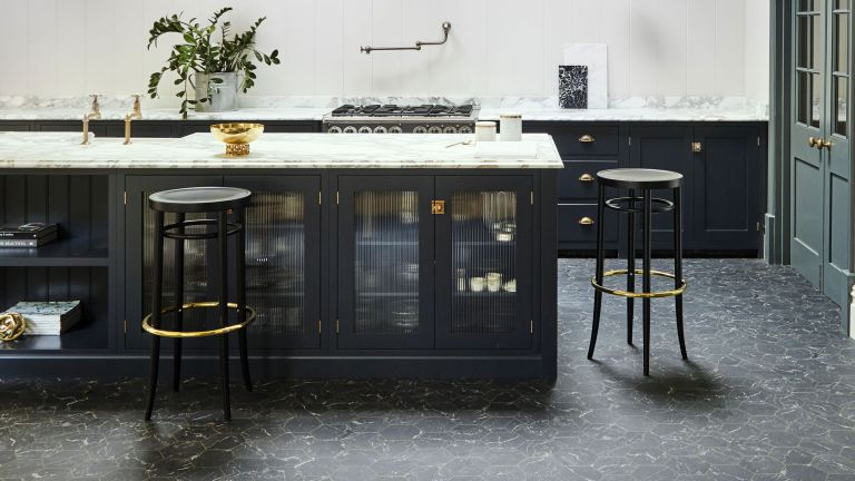 Carpetright Hexagon Black Gold Vinyl tiles in a contemporary kitchen with navy blue cabinetry and ribbed glass