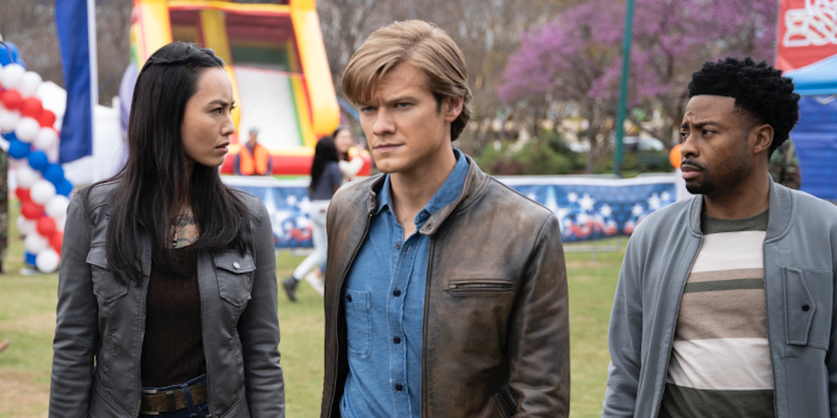 lucas till's macgyver with partners at a town festival on macgyver