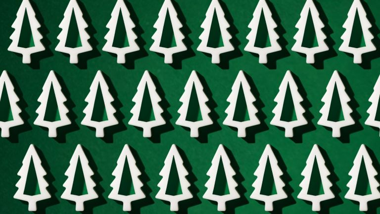 green background white tree shapes