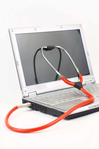 Stethoscope connected to laptop computer via USB port