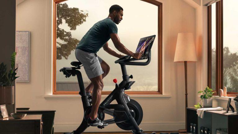 Man on a Peloton bike