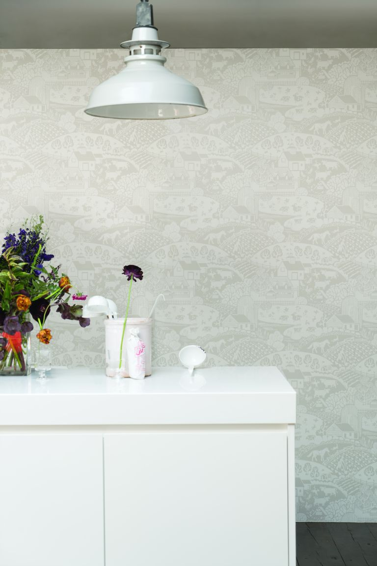 Off white embossed wallpaper in modern kitchen with island