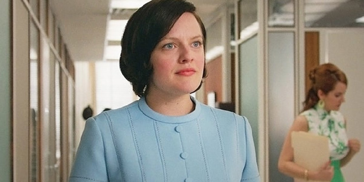 Elisabeth Moss as her iconic role as Peggy Olson in the TV show, Mad Men.