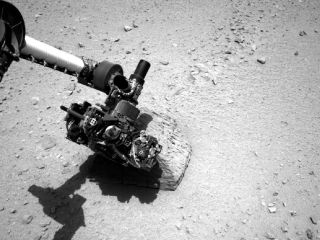 Curiosity's Robotic Arm Touching Rock 'Jake Matijevic'