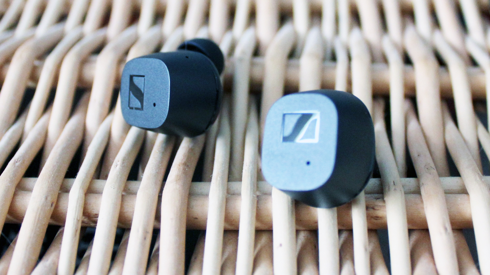 sennheiser cx true wireless earbuds on a wicker background