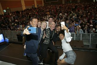 "The cast of ""Star Trek: Discovery"" snaps a selfie with the crowd at the show's Comic-Con 2017 panel on July 22, 2017 in San Diego, California."