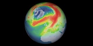A satellite image shows the new ozone hole spreading over the North Pole.