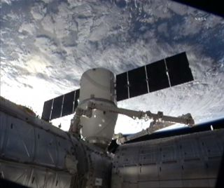The SpaceX Dragon cargo capsule is seen with Earth in the background during docking at the International Space Station on March 3, 2013.
