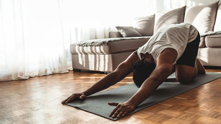Man doing a pilates workout for his back
