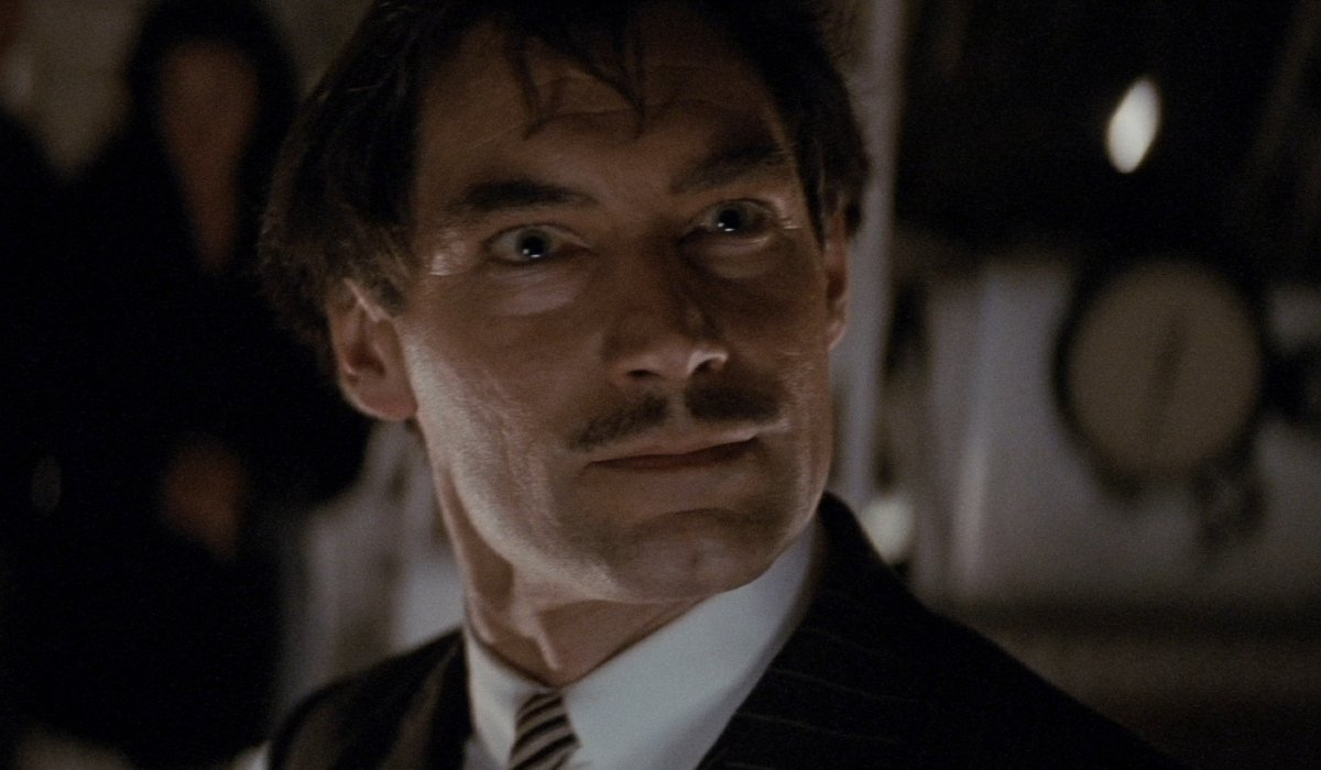 Neville Sinclair looking messy in the zeppelin in The Rocketeer.