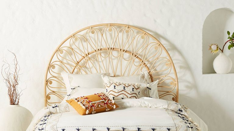 Anthropologie sale: Bedroom with rattan headboard by anthropologie