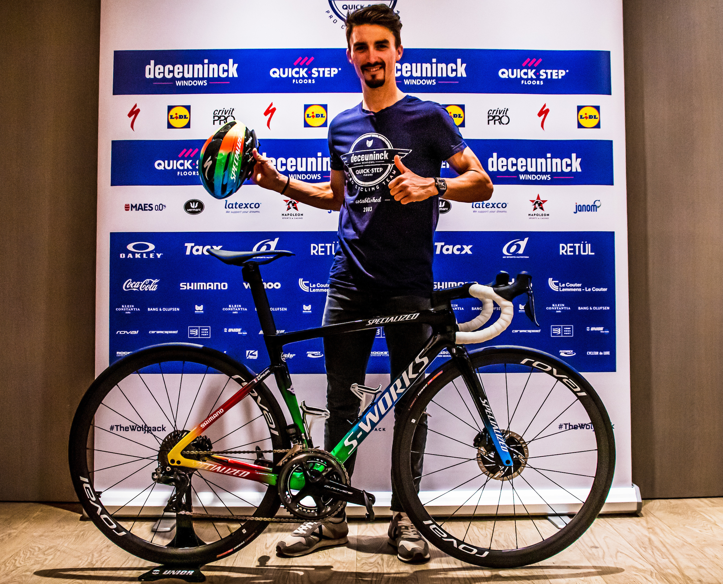 Julian Alaphilippe seems to like his new rainbow-coloured race bike
