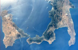 Mount Etna and Mount Stromboli in daylight from space