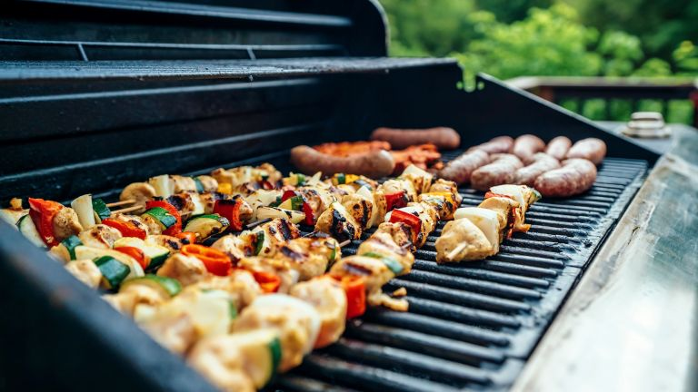 Grill with kabobs and other yummy food
