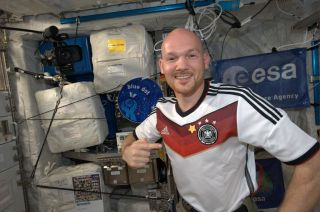 Alex Gerst points to the star he sewed on his jersey after Germany's World Cup win.