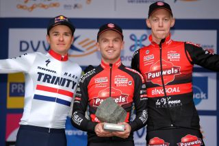 Winner Eli Iserbyt (centre) and Pauwels Sauzen-Bingoal teammate Michael Vanthourenhout (right) share the podium with British champion Tom Pidcock after the 2019 Koppenbergcross