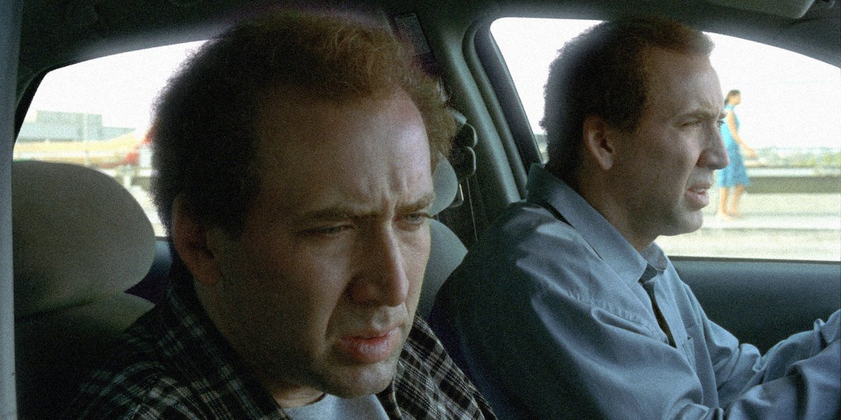 Charlie Kaufman (Nicolas Cage) drives a car with his twin brother Donald Kaufman (Nicolas Cage) sitting in the passenger seat in 'Adaptation'