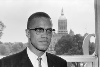 Malcolm X pictured in front of the state capitol Hartford, Connecticut, June 4, 1963