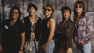 Bon Jovi with Such and Sambora in 1990