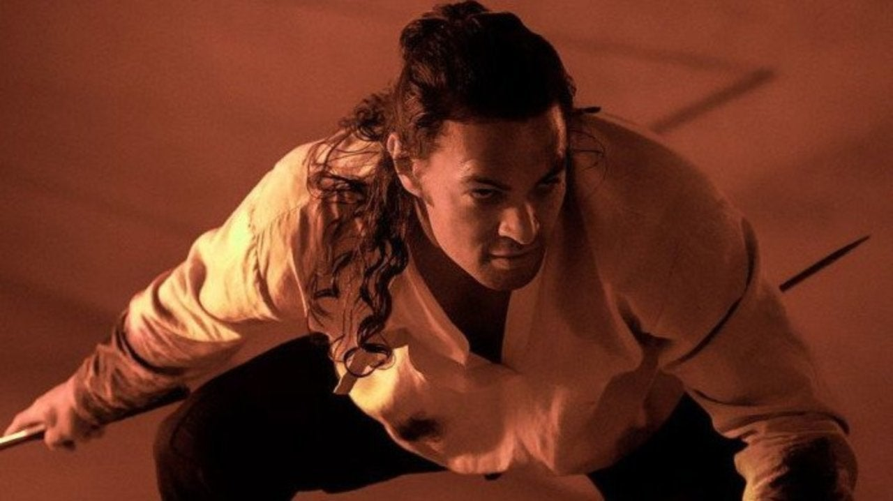 Duncan crouches in a scene from Dune