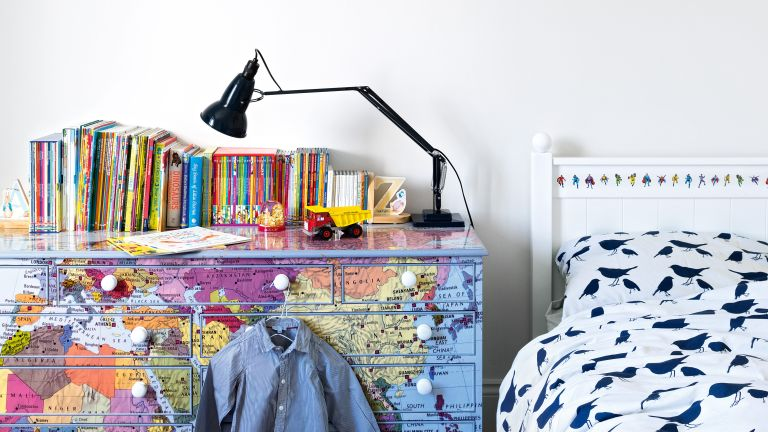 Boys bedroom with drawers covered in maps
