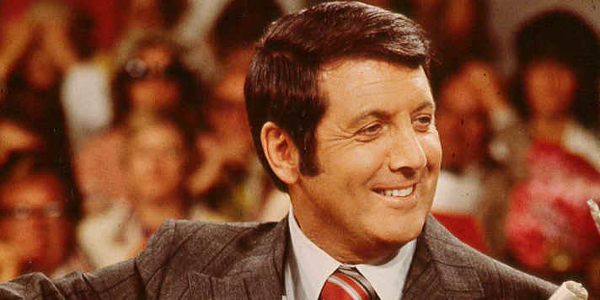Let's Make A Deal Monty Hall smiling and dealing