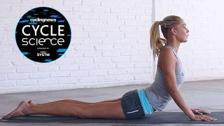 Yoga instructor performing a lumbar stretch