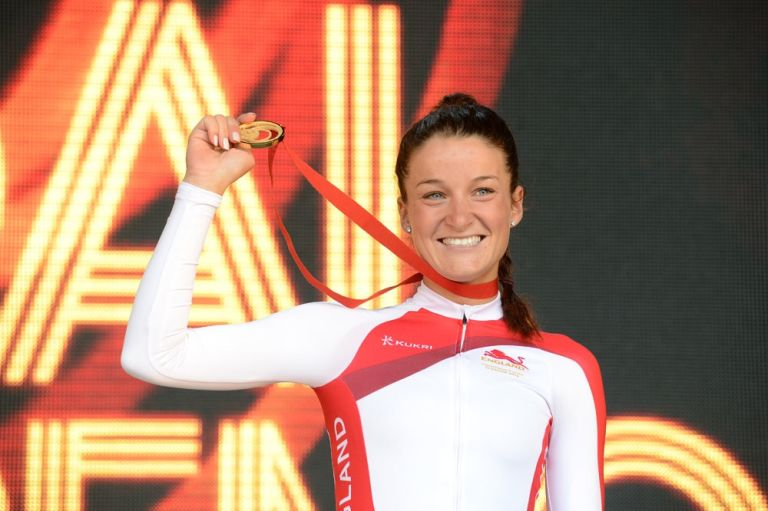 Lizzie Armitstead holds up her Commonwealth Games gold medal after the women's road race (Andy Jones)