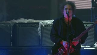 Robert Smith onstage with The Cure
